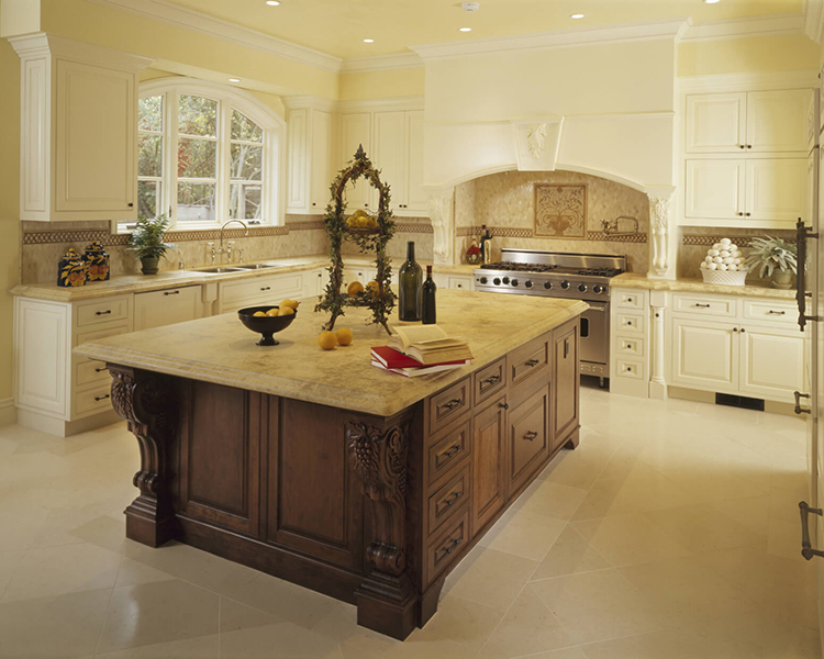 White Luxury Kitchen with intracate carved wood island