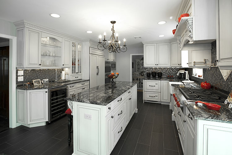 White Luxury Kitchen with black granite and black tile