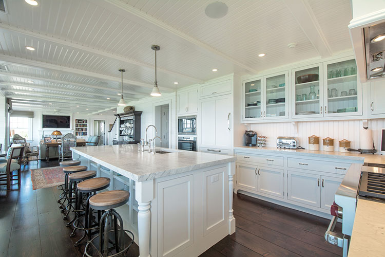 White Luxury Kitchen with eat in island