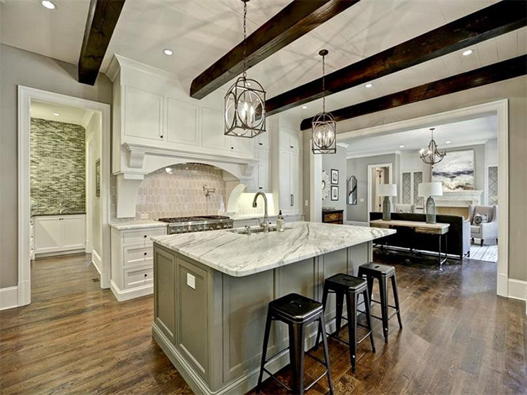 White Luxury Kitchen with dark wood ceiling beams
