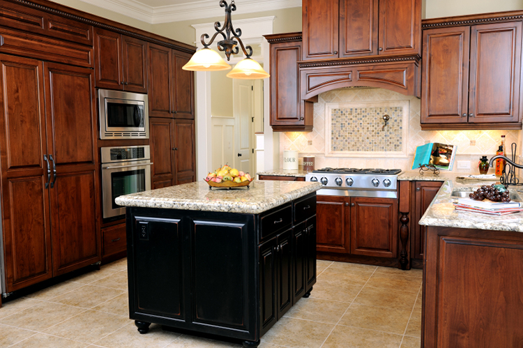 Luxury Kitchen with black island and granite counter top