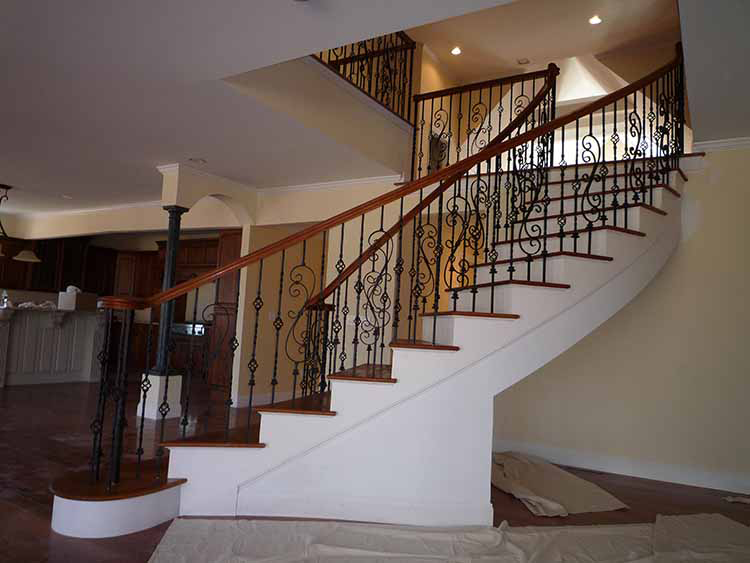 Lifetime Luxury Amazing Stair Design - curve staircase turning left with wooden handrails and decorated iron balustrade -046
