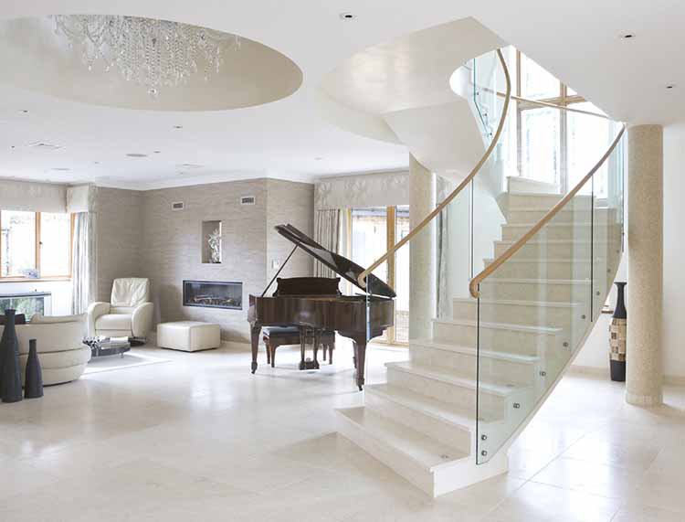 Lifetime Luxury Amazing Stair Design - white curved staircase turning left with walnut handrail, glass panel balustrade -117