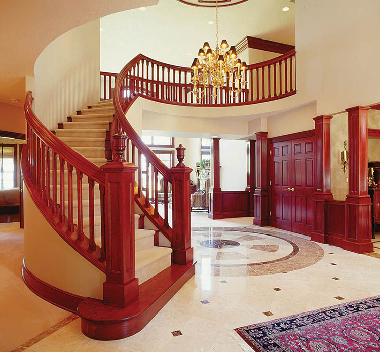 Lifetime Luxury Amazing Stair Design - curved staircase turning right with white full skirt board, white stairs, cherry wooden handrails and balustrade with decorations - 204