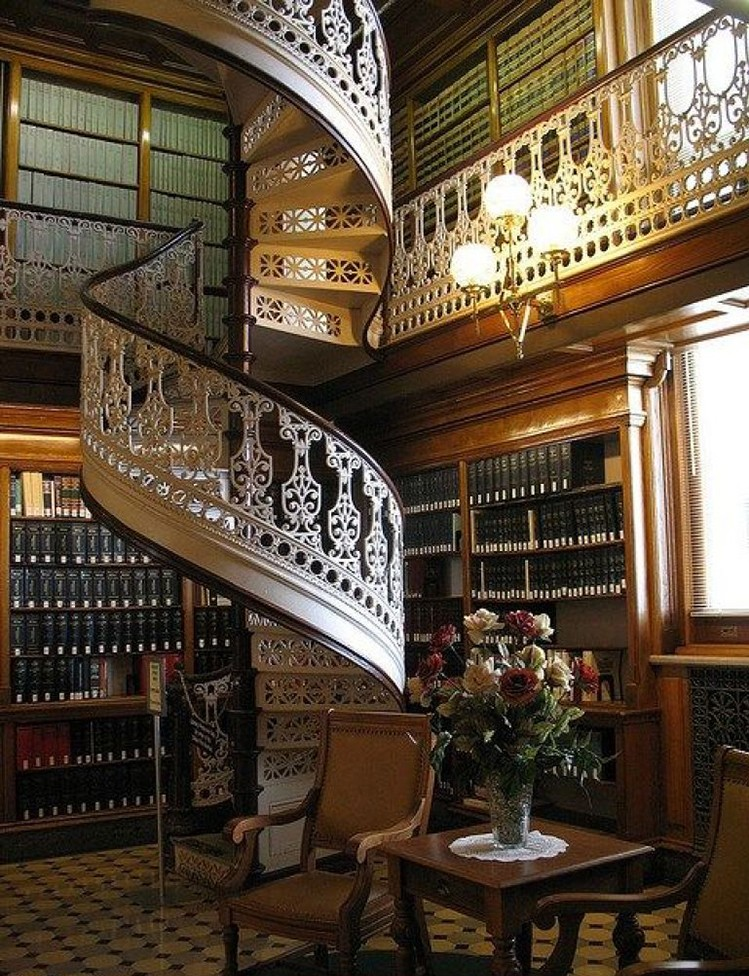 Lifetime Luxury Amazing Stair Design - traditional iron circular staircase with intermediate landings going left. The balusters are white and heavily decorated with floral motifs; handrails in dark wallnut wood, white large skirt board with wooden edge -211