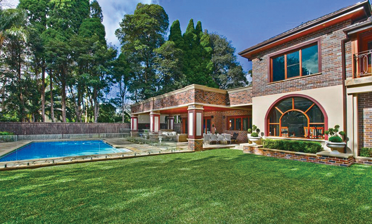 Lifetime Luxury - Italian style two storey villa with huge terrace over a covered porch substained by Latin columns, swimming pool in front, large meadow in foreground and wood on the background - Unique Architecture Design170