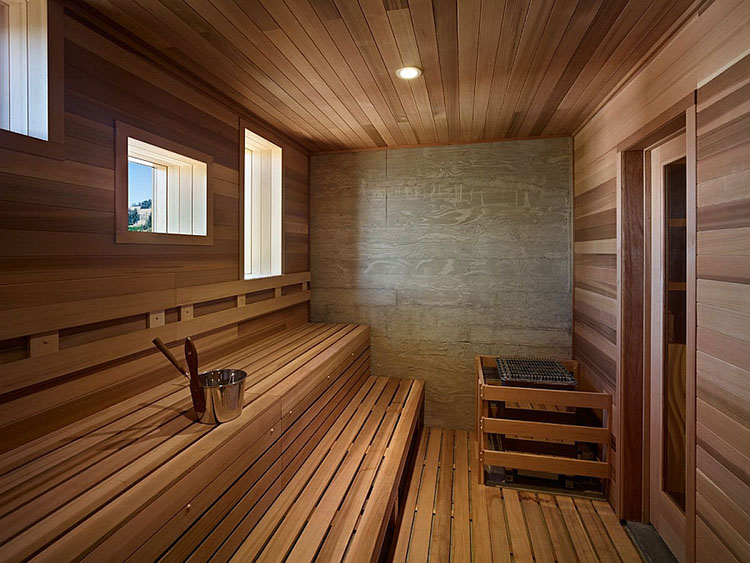 Luxury Home Sauna - inside a classical birch sauna cabinet. Wooden benches, brazier and metal bucket - LifetimeLuxury004