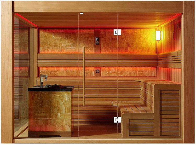 Luxury Home Sauna - brazier in-built in an island and birch benches glimpsed through the glass panels - LifetimeLuxury005