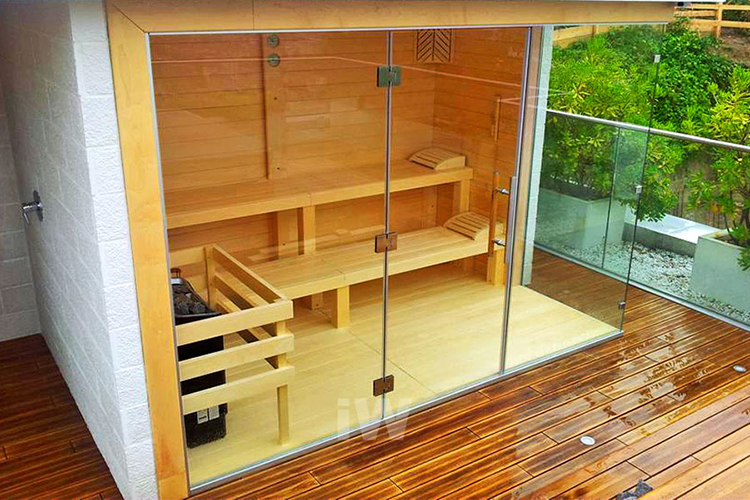 Luxury Home Sauna - small Finnish in-home sauna with glass panel walls and scenic view on the garden - LifetimeLuxury108