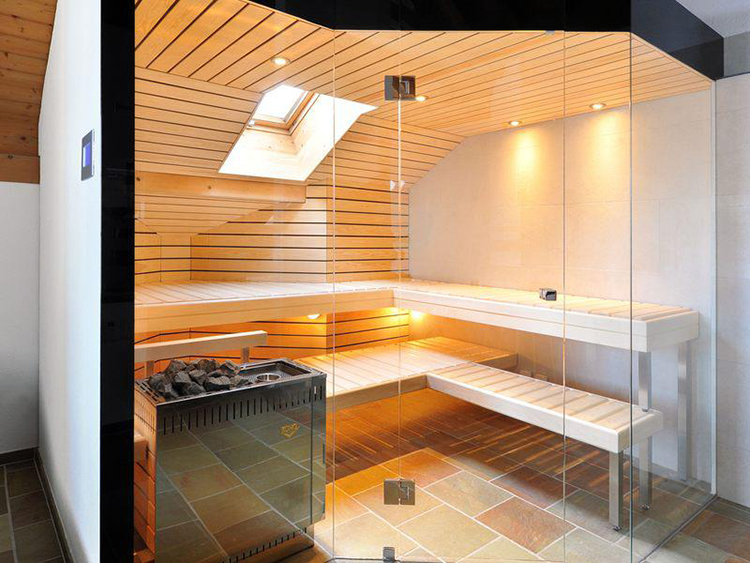 Luxury Home Sauna - an attic with a sauna cabinet in the foreground. The glass panels of the front wall are irregularly disposed - LifetimeLuxury152