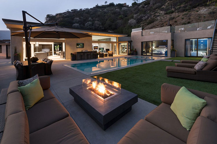 Luxury Patio Ideas - villa with modern design outdoor patio set around a swimming pool - LifetimeLuxury017