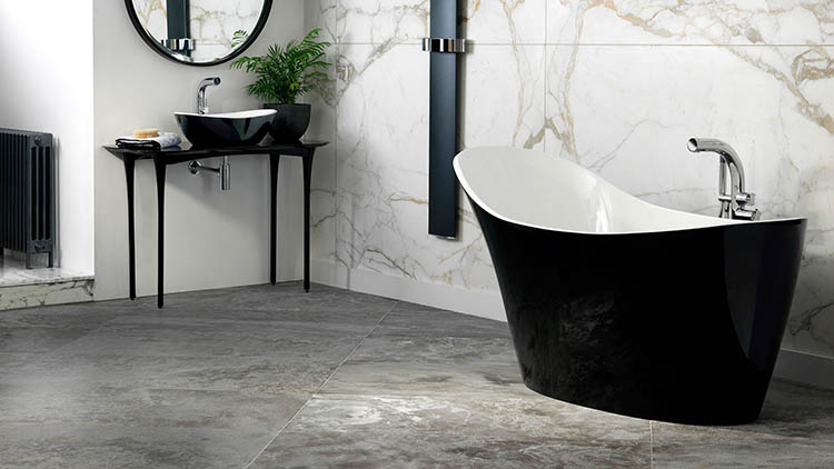 02. Luxury bath gallery - Amalfi_black_bathtub placed in a white bathroom with grey floor and small black dressing table with round vanity mirror -