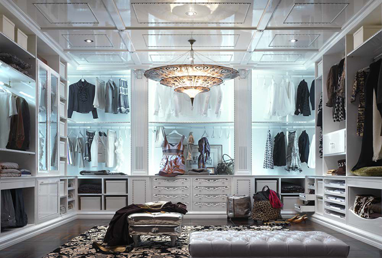 Lifetime Luxury - Luxury Closet Ideas009 inside a posh white cabinet with clothe racks everywhere, drawers on the lower level, nice chandelier -