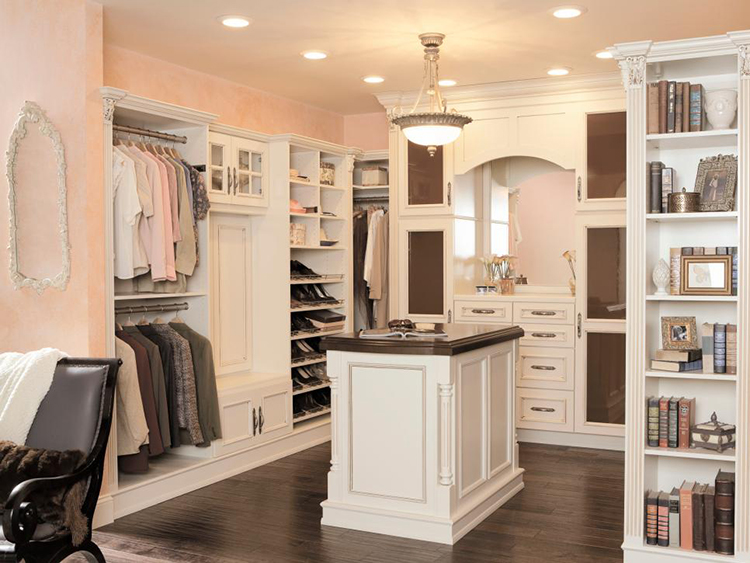 Lifetime Luxury - Luxury Closet Ideas019 - inside a white closet with island in the middle and an element with an arch. Clother rack, shoe rack and again narrow clother rack -