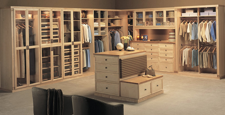 Lifetime Luxury - Luxury Closet Ideas023 - inside a modern wooden closet with central island -