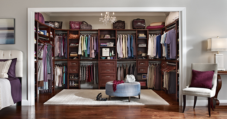 Lifetime Luxury - Luxury Closet Ideas025 - classical modular dark wallnut wooden closet with clothe racks and drawers, round bench in the middle -
