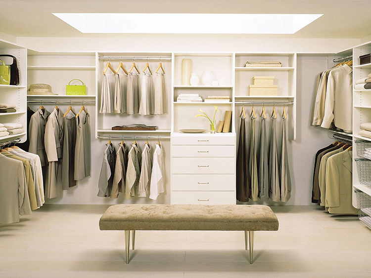 Lifetime Luxury - Luxury Closet Ideas046 - modular modern design closet with long white low bench and rectangular big ceiling window. Clothe racks almost everywhere, except for some shelves and an element with drawers placed in the middle -