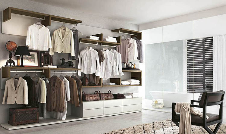Lifetime Luxury - Luxury Closet Ideas047 - wall open closet composed mainly of clothe racks in a combined space . We glimpse a bathroom in the background that is separated with a huge glass panel door -