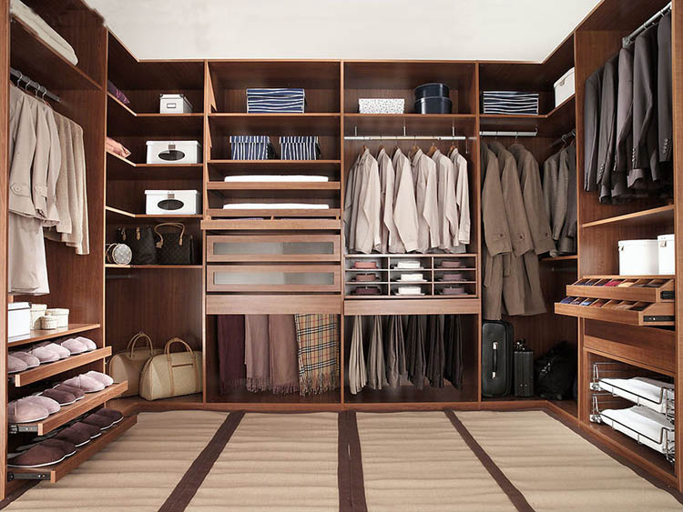 Lifetime Luxury - Luxury Closet Ideas059 - light modular wallnut wooden closet - interior - white carpet on the floor. Shoe racks on the left, drawers and a clothe rack on the right, clothe racks, shelves, drawers on the front -