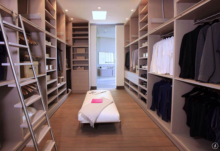Lifetime Luxury - Luxury Closet Ideas066 - modern modular closet - interior - long white low bench, ladder in the foreground -