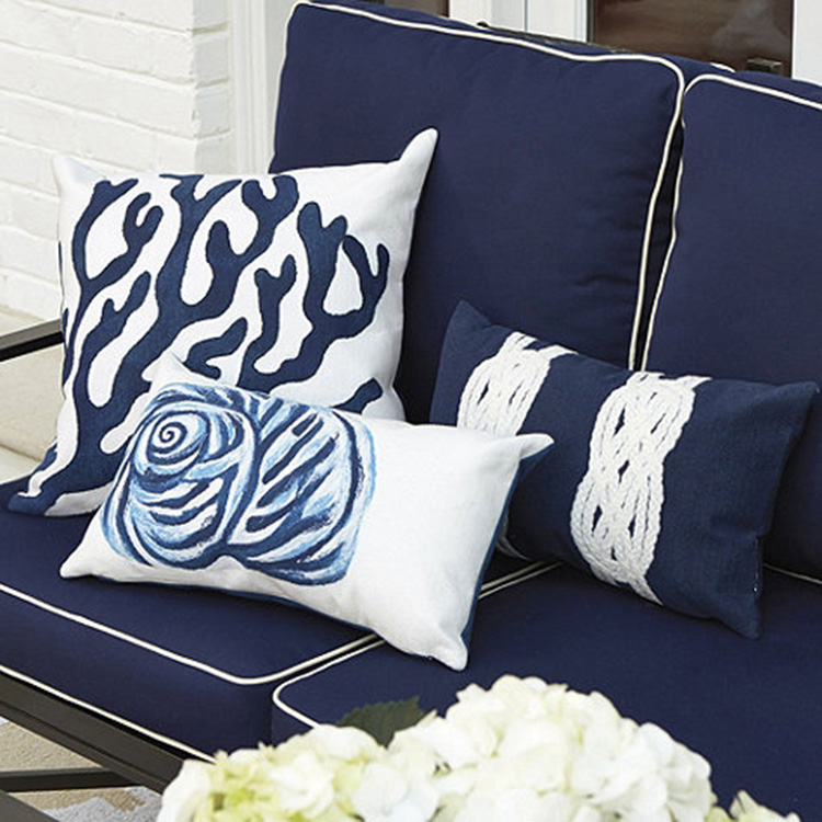 12.decorative pillows gallery - Ballard Designs Pillow-three small pillows (two with white grounds, one with blue ground) set on a couch covered with blue pillows with white edges