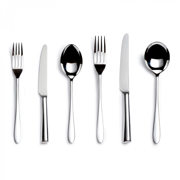 04-stainless cutlery - modern design - one fork, one knife, one spoon, and again one fork one kinfe one spoon on a white background