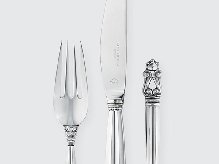 06. best flatware sets - Georgjensen _cutlery_silver_set_acorn- details of a fork and a knife on white background