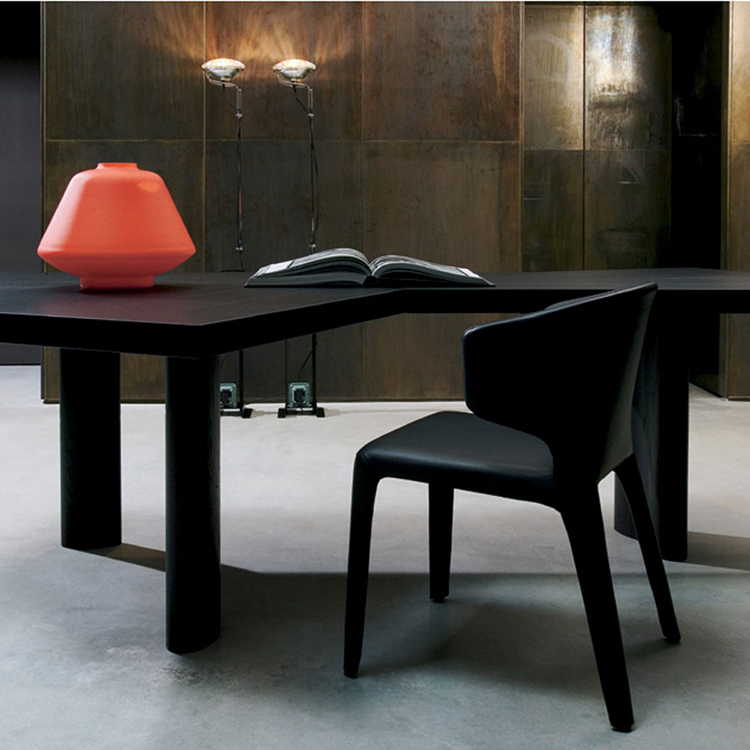 27.luxury chair gallery -Hannes Wettstein Hola Chair standing in front of a dark table