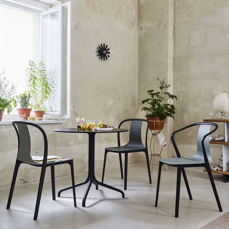 "24 luxury chairs gallery - Ronan and Erwan Bouroullec Chiar four balck ""Belleville"" chairs aorund a round table in a white room"