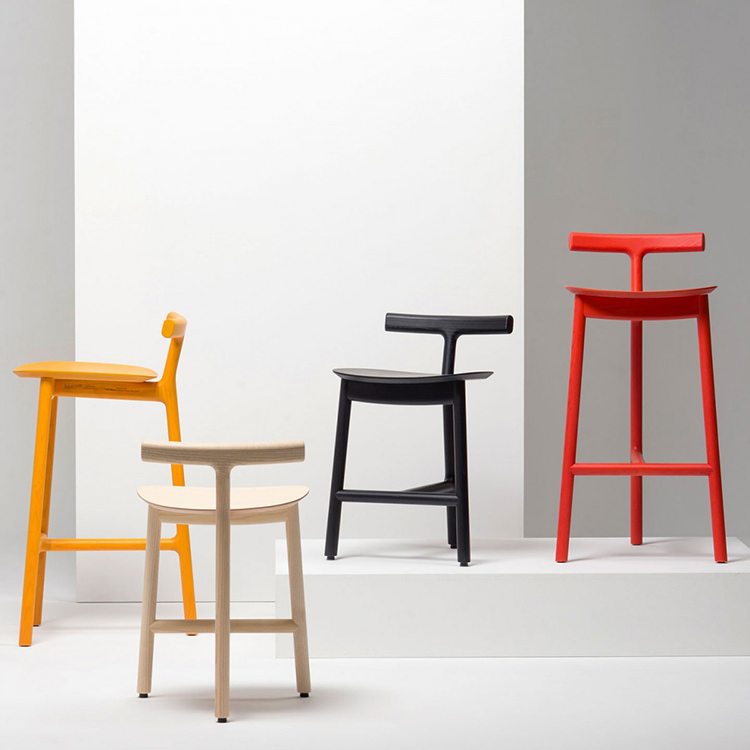 25 luxury chair gallery Sam Hecht Chair four radice -moving from left to right yellow white black red - on white background