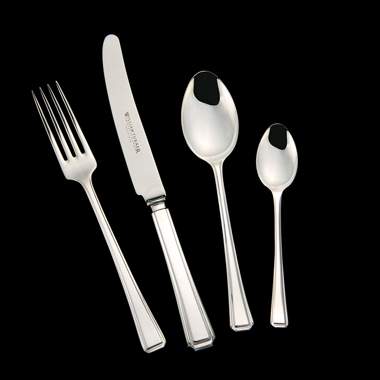 12 best flatware sets gallery- Sheffield Cutlery- silver fork, knife, spoon and small spoon on a black background