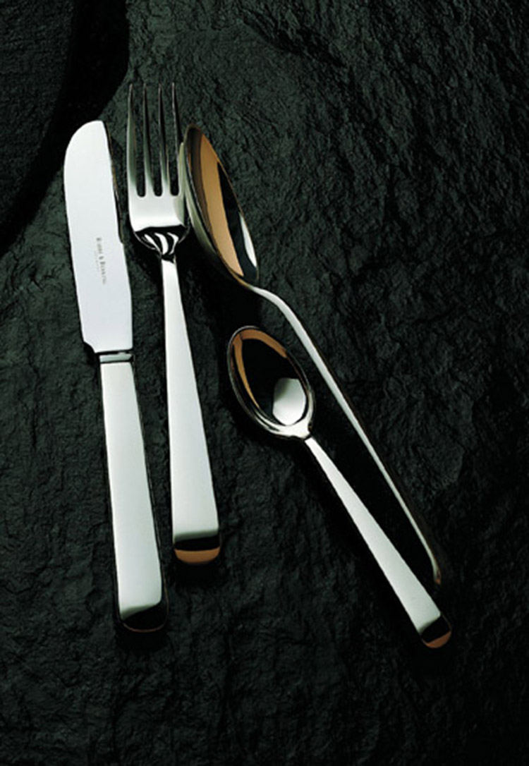 11. best flatware sets - Alta_robbe_berking_silver_flatware-one knife,onefork,one small spoon, one big spoon laid on a black rocky surface