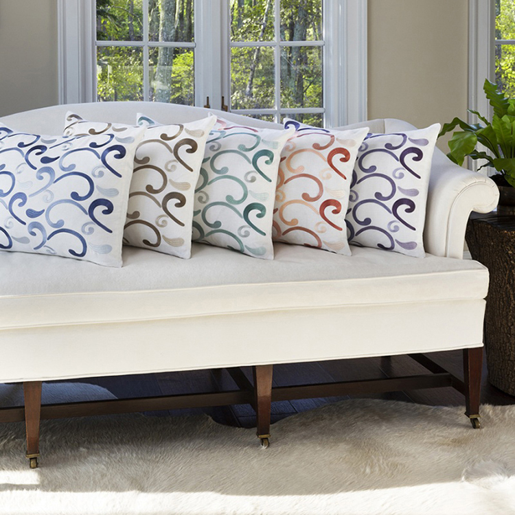 09. decorative pillows gallery - sferra decorative pillows-5 white pillows having wave shaped decorations of 5 different colours and set on a white couch in single line